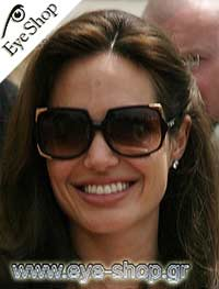 8f5a1231ae86 angelina-jolie-wearing-sunglasses-michael-kors-mks-523 wearing ...