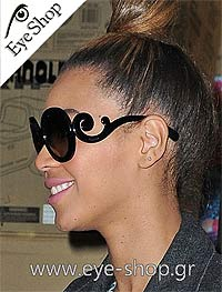 73b702c5f05 Beyonce Knowless wearing the Prada minimal baroque sunglasses   eyeshopgrcelebrities