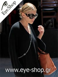 Mary-Kate Olsen wearing the Limited Edition Prada minimal Baroque sunglasses model 27NS color 2AU6S1 Minimal Baroque Limited Edition