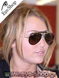 Miley Cyrus wearing Rayban Leather Collection model 3422Q color 919233